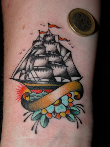 A Coin And Traditional Ship Tattoo