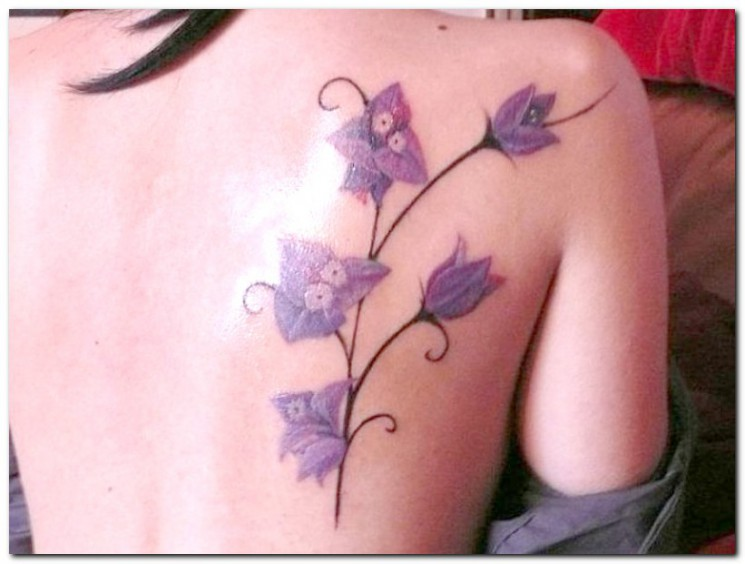 A Cute Girly Tattoo Of A Hummingbird Sipping Nectar From An Orchid Flower