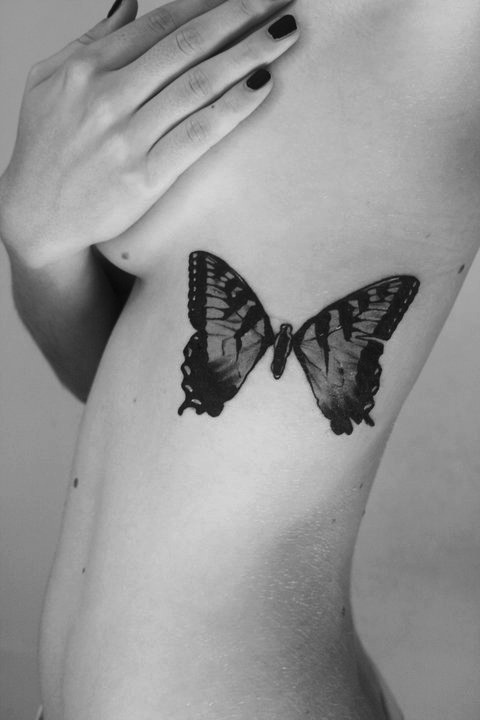 A Monarch Butterfly Insect Tattoo On Rib Side