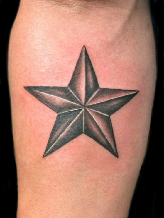 A Small Nautical Star Tattoo On Elbow