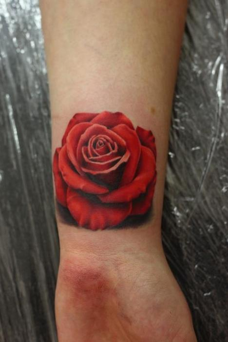 A Very Lovely Red Rose Tattoo On Wrist