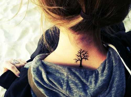 A Very Small Tree Tattoo On Back Neck