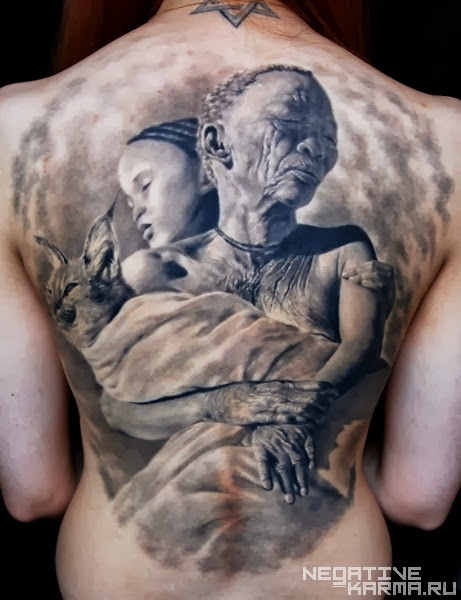African Woman Holding Cat and Child Tattoo On Back