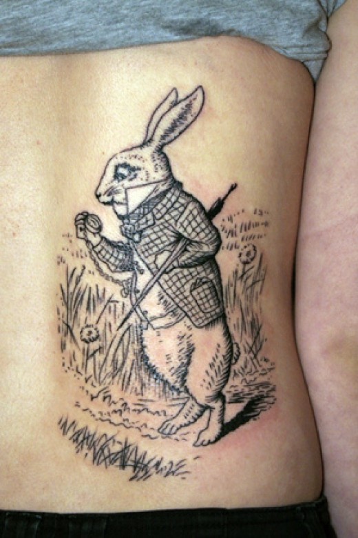 alice rabbit tattoo on foot in 2017 real photo pictures images and sketches tattoo collections. Black Bedroom Furniture Sets. Home Design Ideas