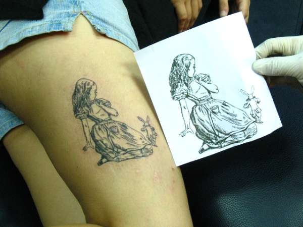 Alice Rabbit Tattoo On Thigh