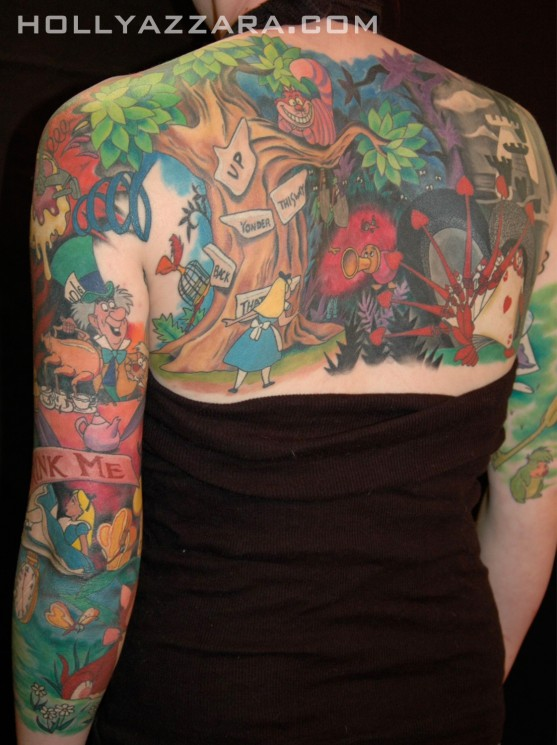 Alice Through The Looking Glass Tattoo On Biceps