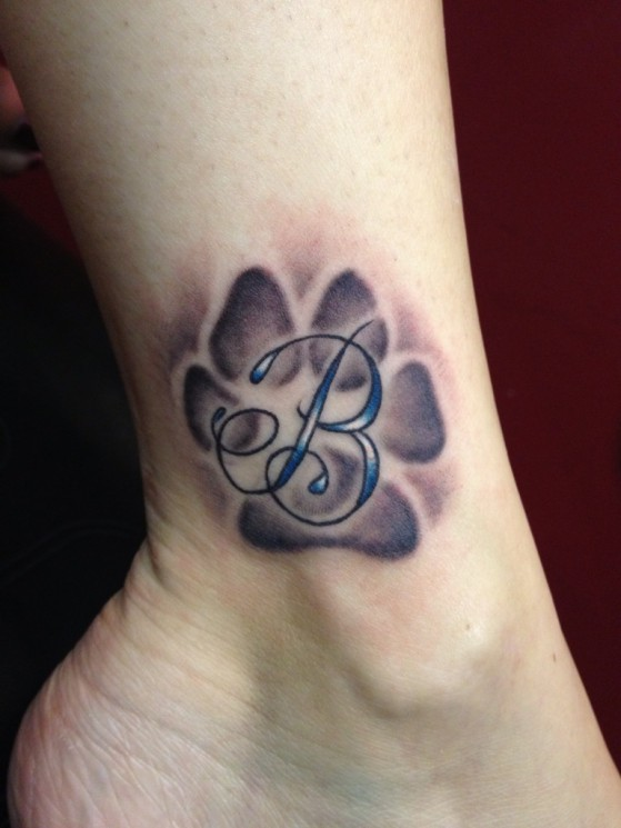 Amazing Black Paw Print And Text Tattoos