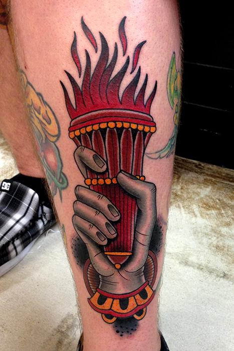 Amazing Traditional Torch Tattoo On Thigh