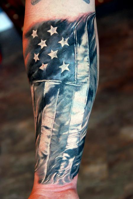 American Flag And Military Tattoos On Forearm