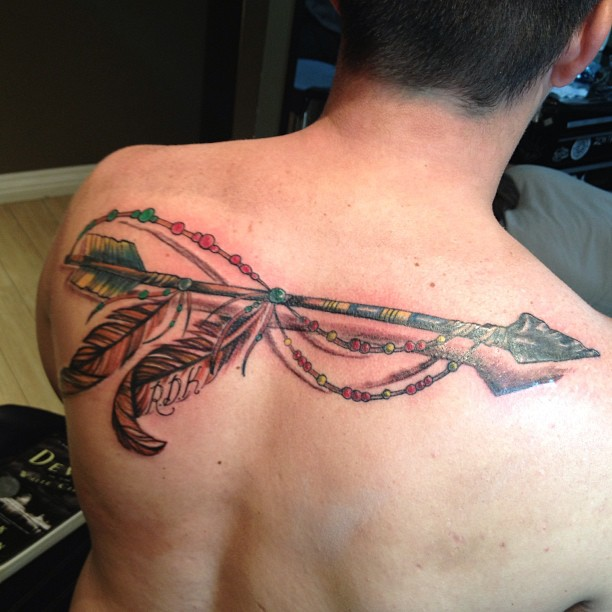 Ancient Arrow Tattoo With Feathers