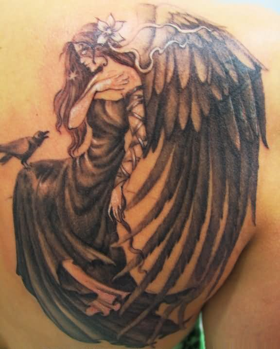 Angel Opening wing Tattoo