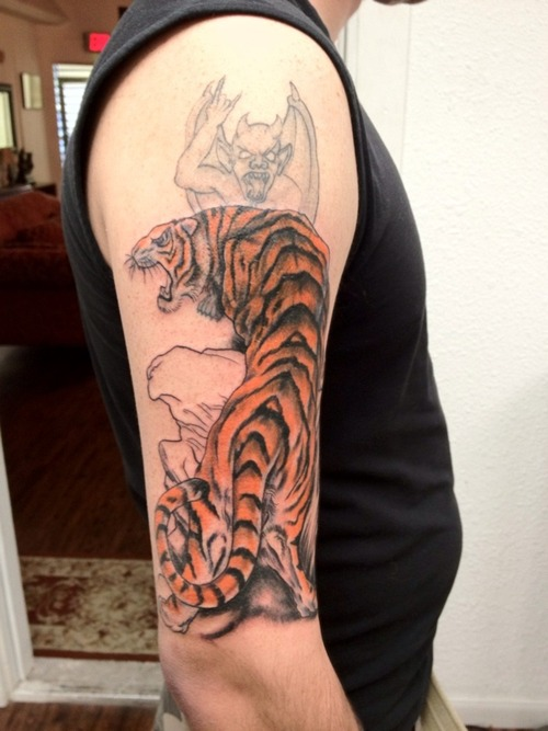 Angry Asian Tiger Tattoo On Biceps