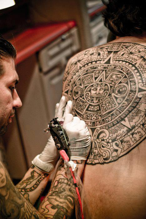 Angry Aztec Sun Tattoo On Back Of Body
