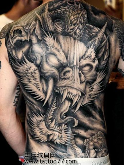 Angry Dragon Ripped Skin Tattoo On Upper Arm
