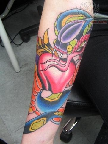 Angry Snake On Red Apple Tattoo Design