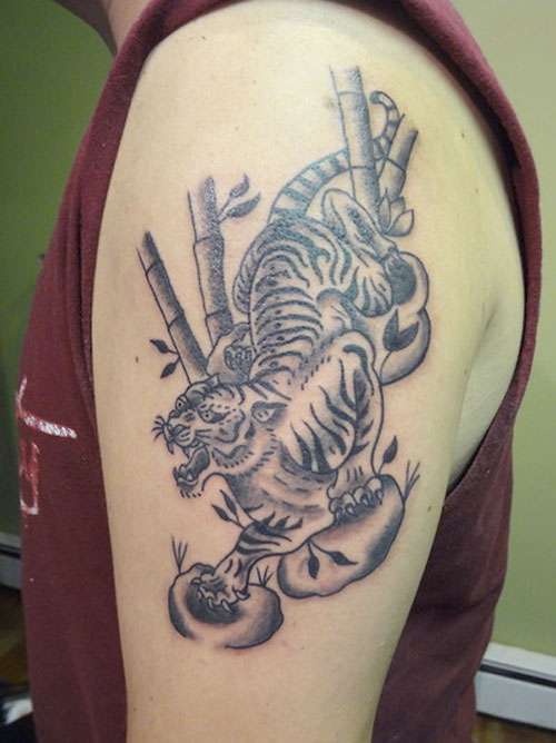 Angry White Tiger And Tree Tattoos On Biceps