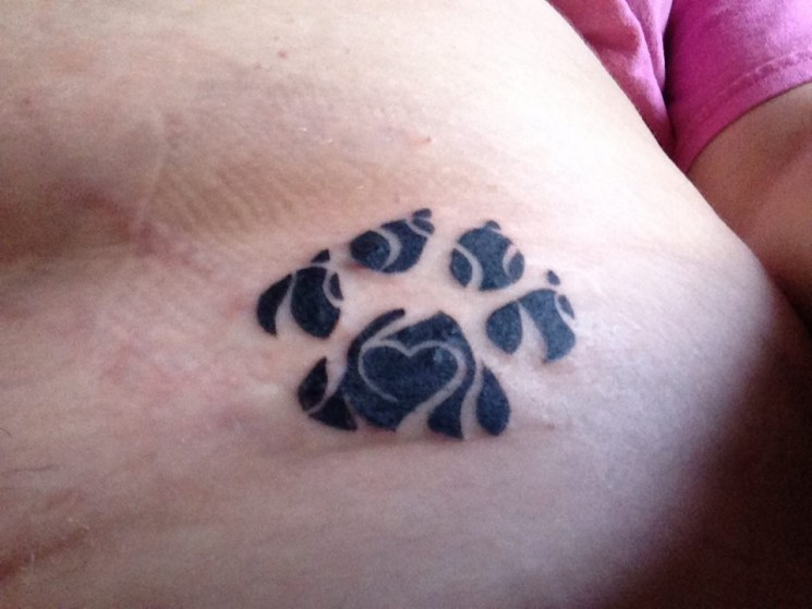 Animal Tribal And Paw Print Tattoos