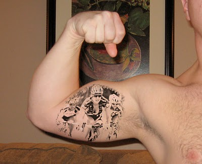 Apple Tattoo On Inner Biceps