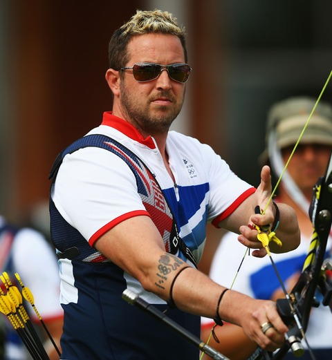 Archer With Olympic Logo Tattoo On Arm