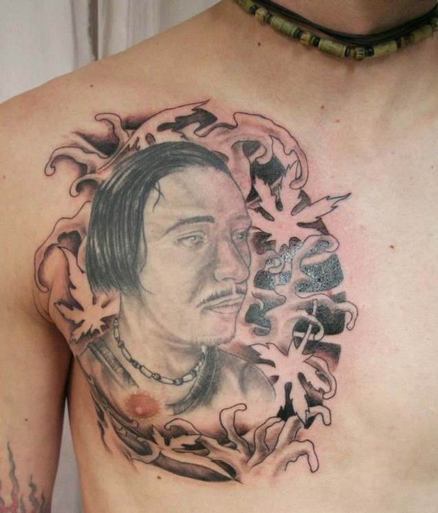 Asian  Man Face Tattoo On Chest