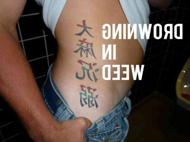Asian Letters Tattoo On Rib Side