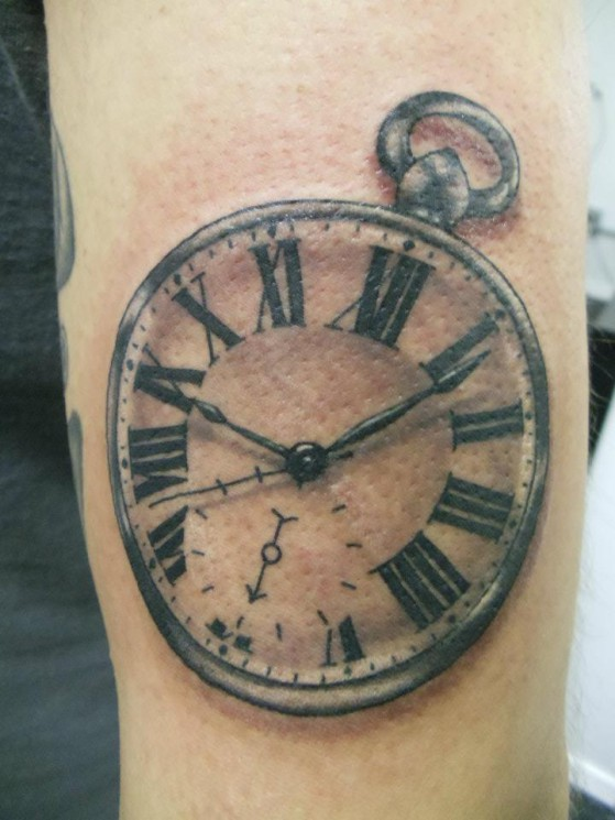 Attractive Ruby Sandclock Tattoo On Lower Arm