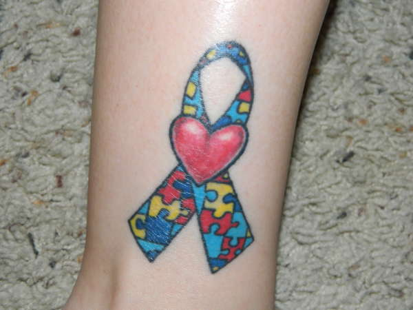 Autism Awareness Ribbon And Cartoon Tattoo