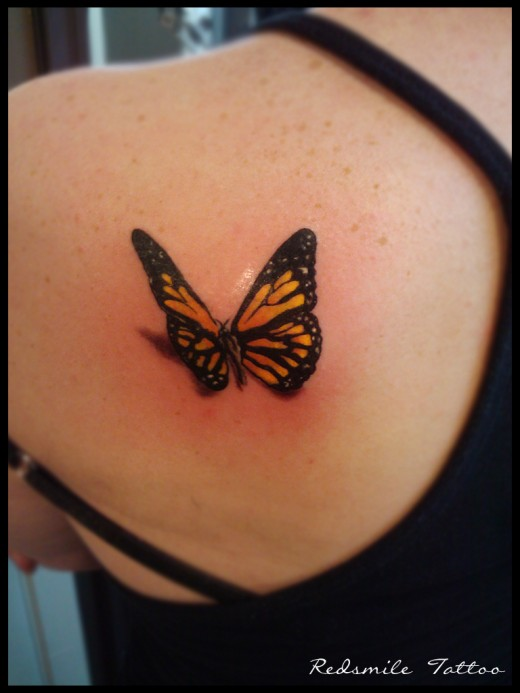Awesome Black Butterfly Tattoo Design