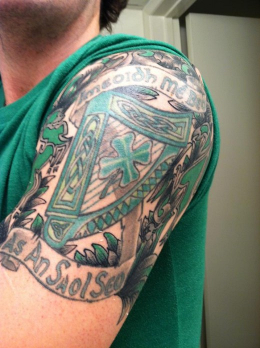 Awesome Family Crest Tattoo On Half Sleeve