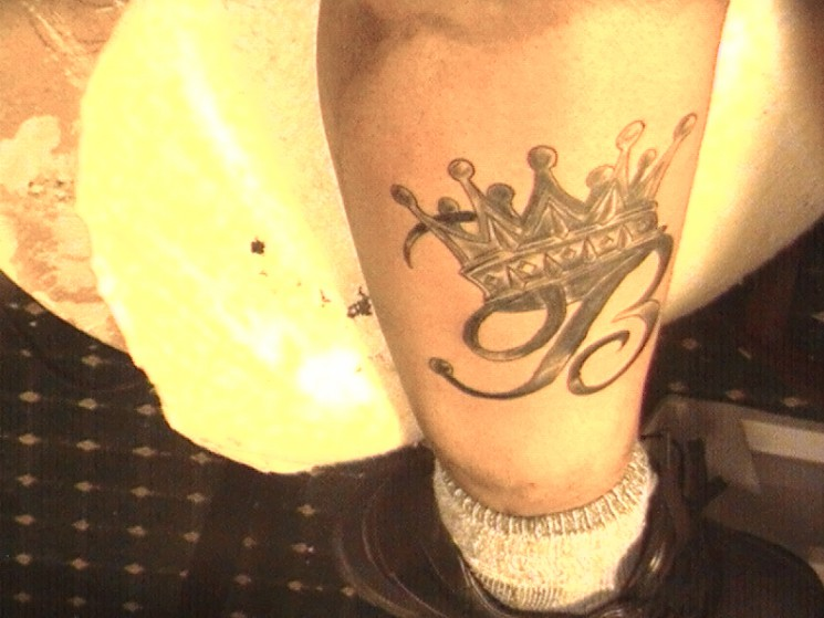 B With Crown Tattoo On Leg
