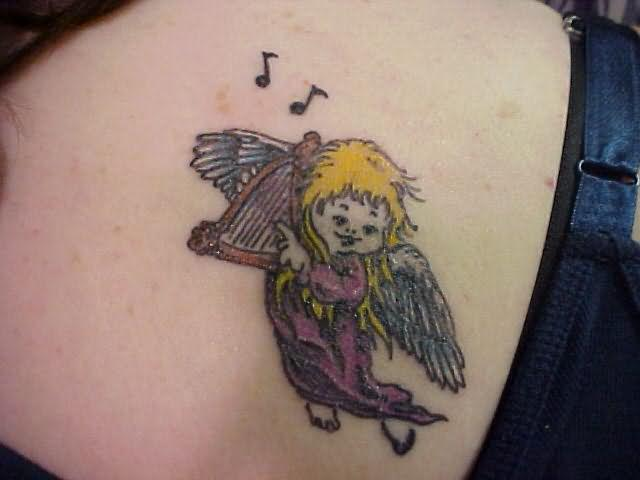 Baby Angel Playing Guitar Tattoo