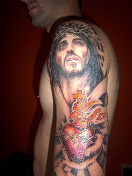 Barbed Jesus Head Tattoo On Inner Muscles
