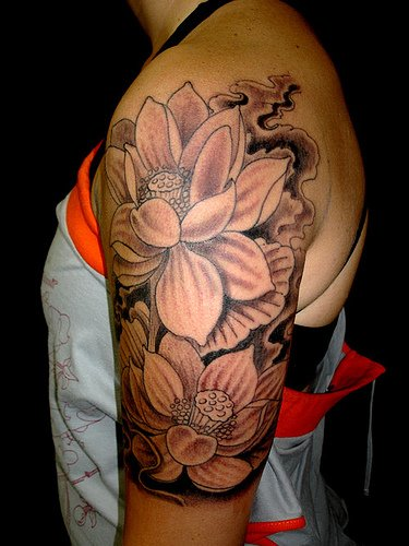 Beautiful Asian Waves Koi And Flower Tattoos On Whole Back
