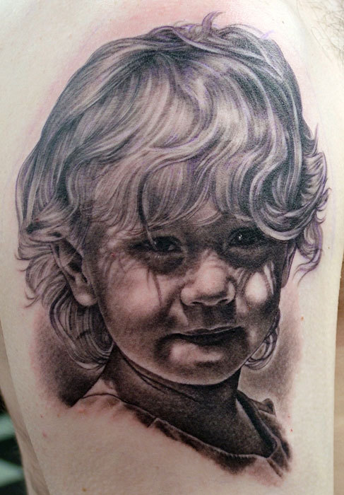 Black And Grey Baby Portrait Tattoo On Arm