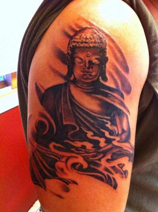 Black And Grey Ink Warrior Tattoo On Biceps