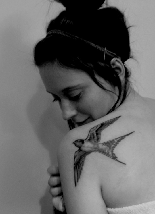 Black And White Literary Tattoo On Back Shoulder