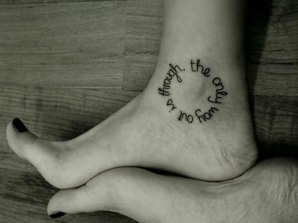 Black And White Word Tattoo On Finger Side