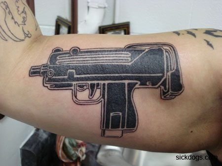 Black Gun Tattoo On  Muscles