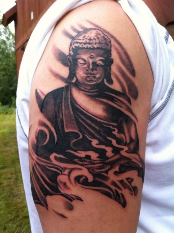 Black Ink Buddhist Tattoo On Shoulder