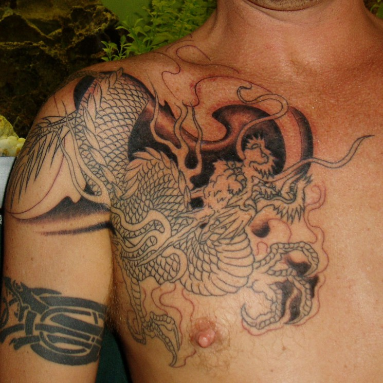 Black Ink Kanji Tattoo Design On Chest