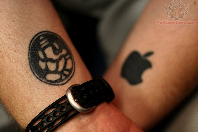 Black Ink Lord Ganesh And Apple Logo Wrist Tattoos