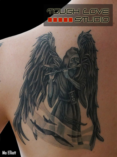 Black Ink Winged Death Tattoo On Muscles