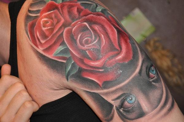 Black Wolf Head And Red Rose Tattoos On Arm
