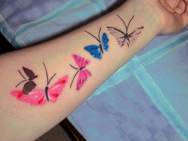 Blue And Red Rose Tattoos On Wrist