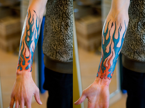 Blue Flames And Sports Tattoo