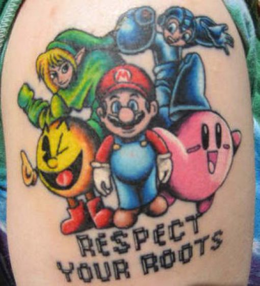 Boy Showing Video Game Character Tattoos On Stomach