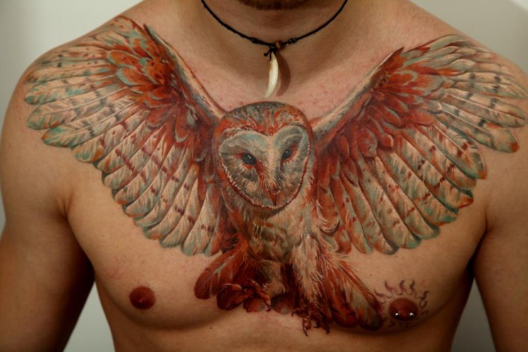 Brown Flying Owl Tattoo On Biceps