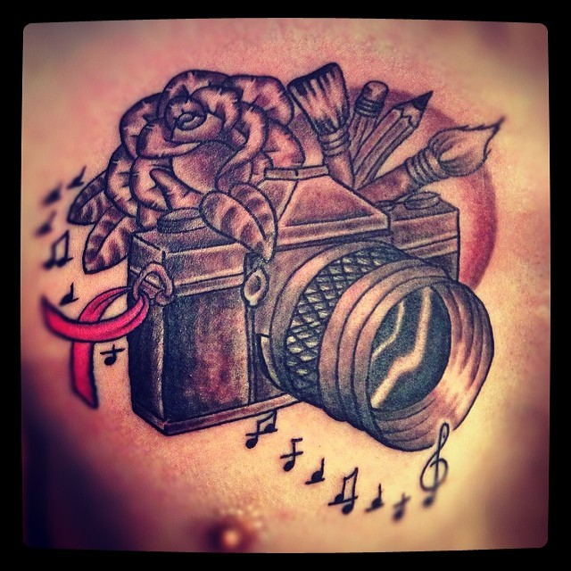 Camera Diagram And Red Roses Tattoos On Chest