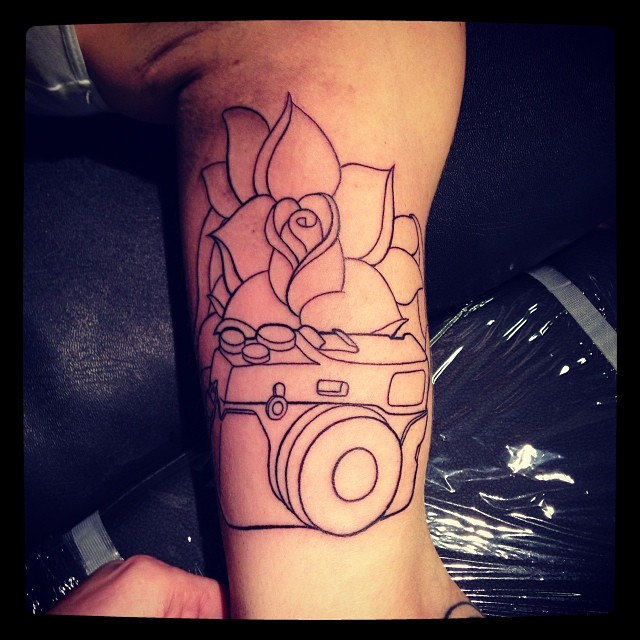 Camera Outline Tattoo On Muscles