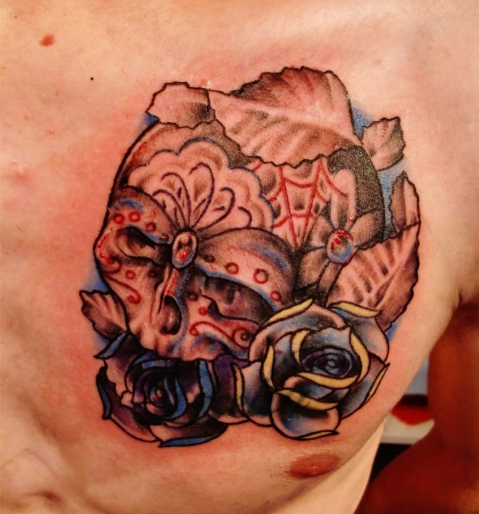 Camera With Red Roses Tattoo On Shoulder